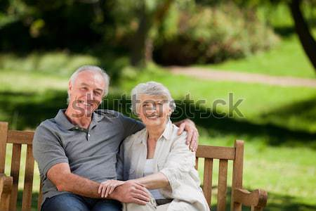 сидят скамейке семьи трава человека Сток-фото © wavebreak_media