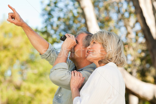 Couple looking at the sky with their binoculars Stock photo © wavebreak_media