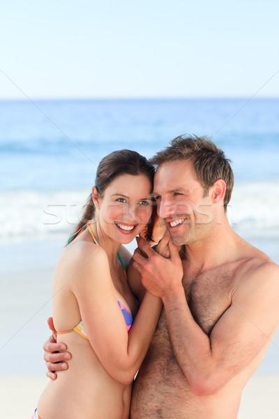 Casal escuta concha mãos feliz mar Foto stock © wavebreak_media
