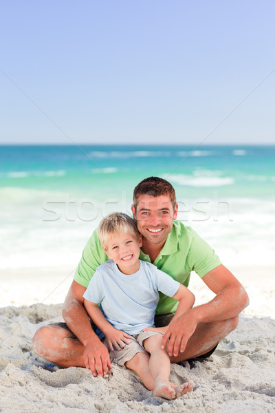 Attentive father with his son at the beach Stock photo © wavebreak_media