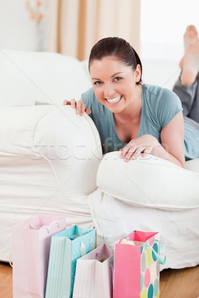 Bájos nő pózol kanapé nappali arc Stock fotó © wavebreak_media