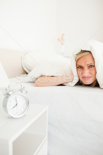 Portrait of a disgruntled young woman waking up in her bedroom Stock photo © wavebreak_media