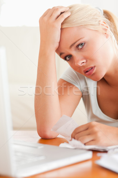 Worried woman doing paperwork in her living room Stock photo © wavebreak_media