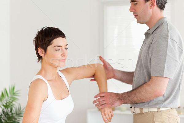 Chiropraticien travail bras chambre main sport Photo stock © wavebreak_media