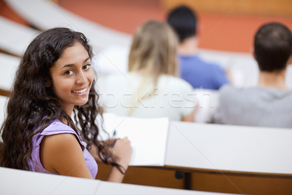 Cute student being distracted in an amphitheater Stock photo © wavebreak_media