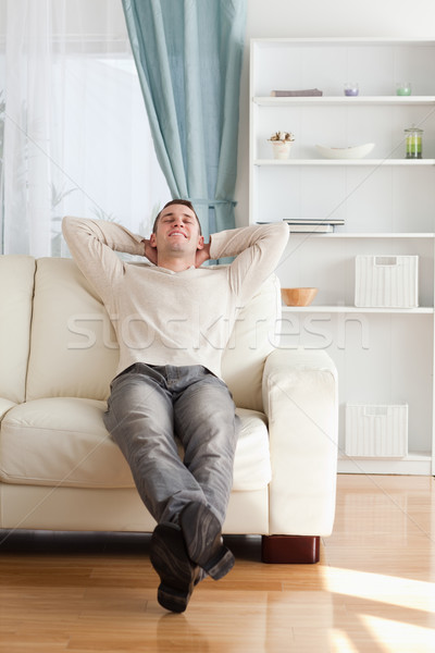 Porträt glücklich Mann entspannenden Couch Wohnzimmer Stock foto © wavebreak_media