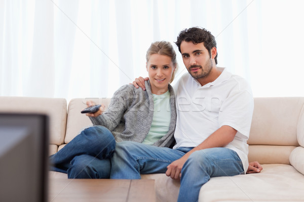 Lovely couple watching TV in their living room Stock photo © wavebreak_media