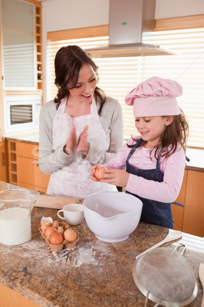 Portrait of a mother teaching her daughter how to bake in a kitchen Stock photo © wavebreak_media