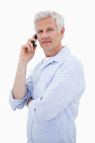 Portret volwassen man telefoongesprek naar camera Stockfoto © wavebreak_media