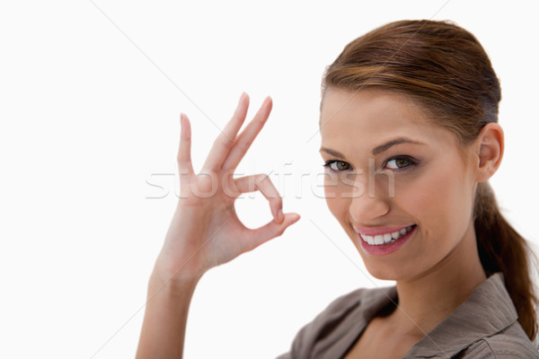 Widok z boku kobieta zatwierdzenie biały szczęśliwy tle Zdjęcia stock © wavebreak_media