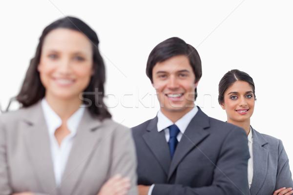Sonriendo jóvenes pie junto doblado armas Foto stock © wavebreak_media