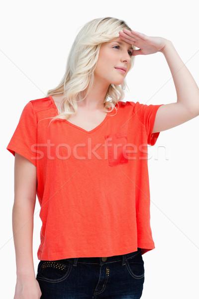 Adolescente mirando lejos lado mano Foto stock © wavebreak_media