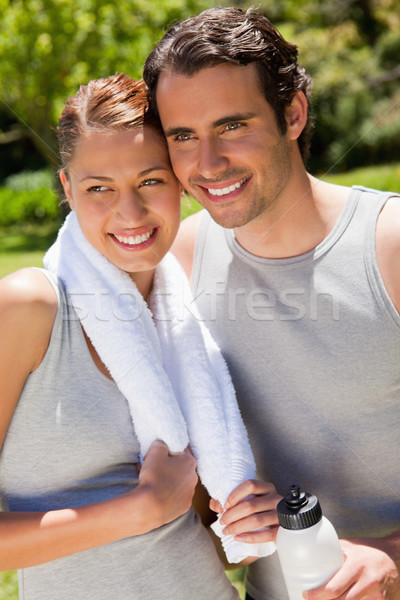 Man holding a white sports bottle smiling with a woman who is holding a towel  Stock photo © wavebreak_media