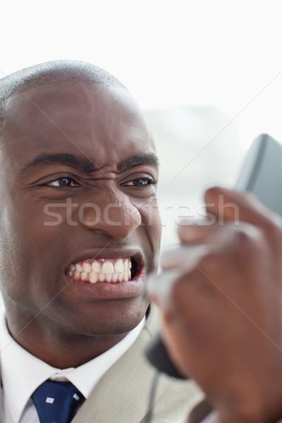 Portré mérges üzletember néz telefon telefonkagyló Stock fotó © wavebreak_media