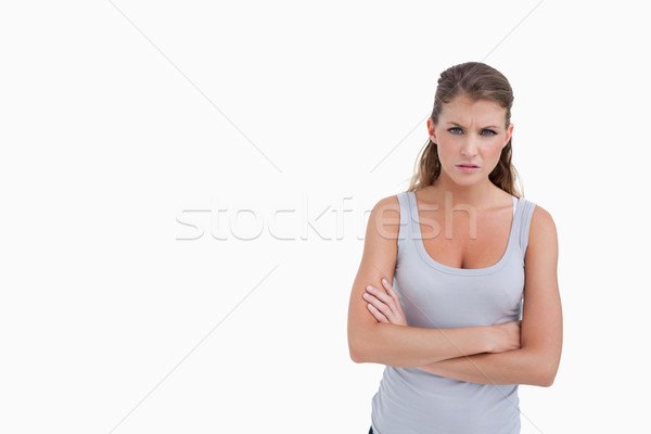 Unhappy woman with the arms crossed against a white background Stock photo © wavebreak_media