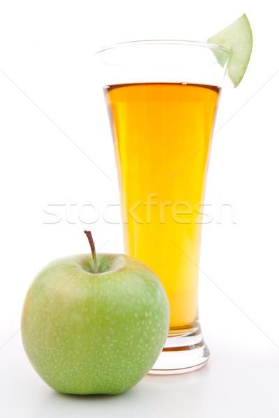 Apple near a glass of apple juice against white background Stock photo © wavebreak_media