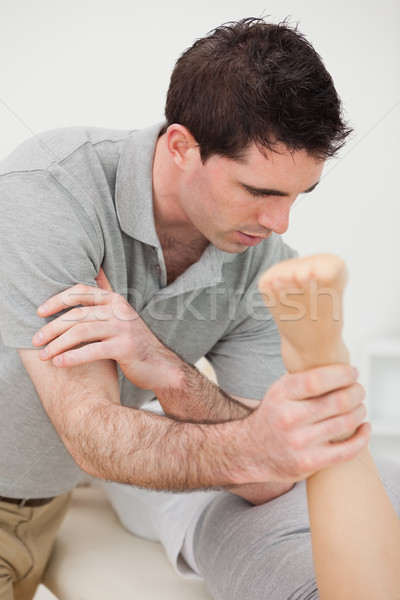 Doctor massaging a patient with his elbow in a room Stock photo © wavebreak_media