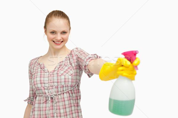 örömteli nő tart spray üveg mosolyog Stock fotó © wavebreak_media
