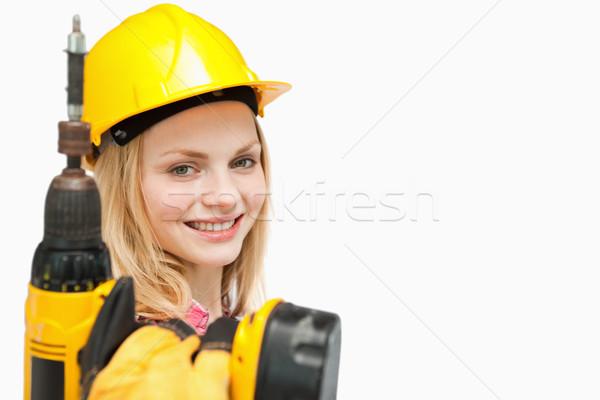 Mulher jovem elétrico chave de fenda branco mão Foto stock © wavebreak_media