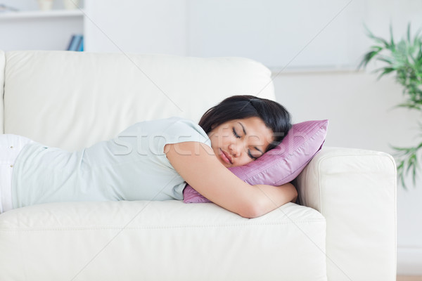 Woman holding a pillow while sleeping on a couch in a living room Stock photo © wavebreak_media