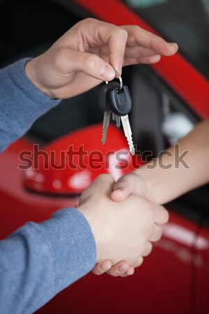 Close up of two persons shaking hand in a garage Stock photo © wavebreak_media