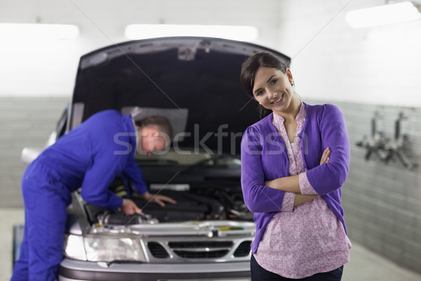 Front view of a smiling client looking at camera in a garage Stock photo © wavebreak_media