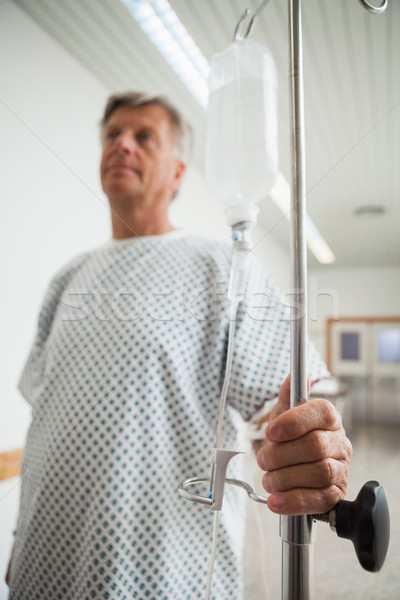 Patient holding onto IV drip in hospital corridor Stock photo © wavebreak_media