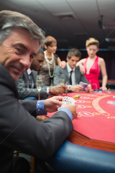 улыбаясь человека покер игры казино Сток-фото © wavebreak_media