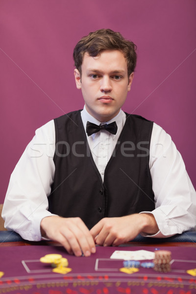Dealer sitting at table in a casino while grabbing chips Stock photo © wavebreak_media