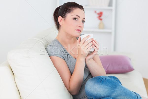 Donna seduta divano soggiorno Foto d'archivio © wavebreak_media
