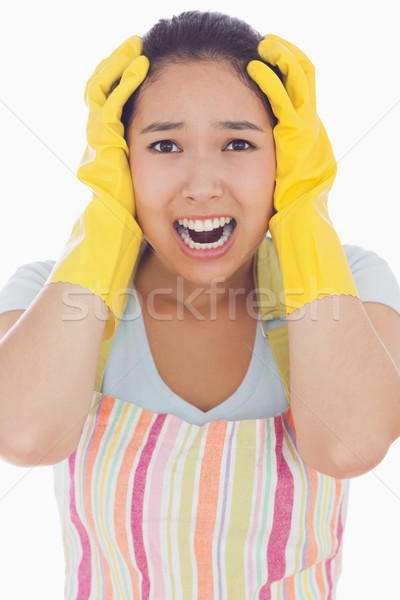 Stressed woman wearing rubber gloves and apron with her hands on head and screaming Stock photo © wavebreak_media