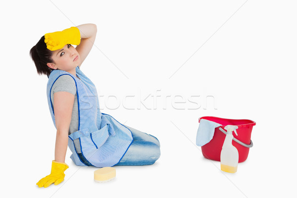 Exhausted woman cleaning the floor on the white background Stock photo © wavebreak_media