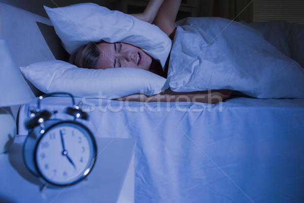 ブロンド 女性 枕 耳 1泊 女性 ストックフォト © wavebreak_media