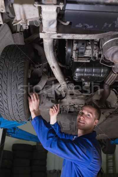 Happy mechanic under car Stock photo © wavebreak_media