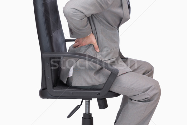 Business man with backache sitting in an office chair Stock photo © wavebreak_media