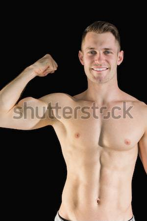 Portrait of bare chested young man with arms crossed Stock photo © wavebreak_media