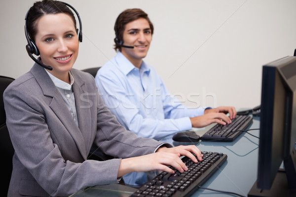 Happy call center employees at work Stock photo © wavebreak_media