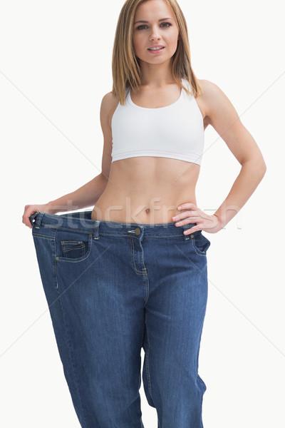 Portre genç kadın eski pantolon Stok fotoğraf © wavebreak_media