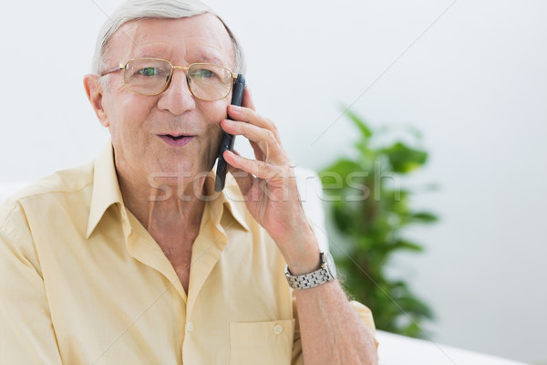 Elderly man phoning  Stock photo © wavebreak_media