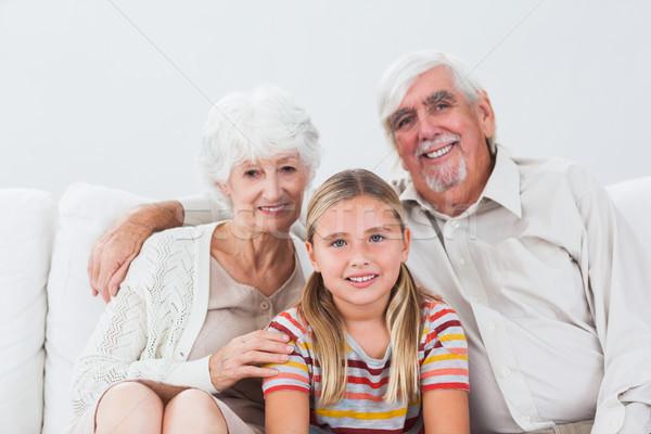 внучка дедушка и бабушка улыбаясь диване дома девушки Сток-фото © wavebreak_media