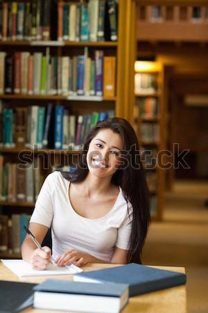 Student taking notes in library Stock photo © wavebreak_media