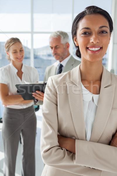 гордый деловая женщина коллеги рабочих за служба Сток-фото © wavebreak_media