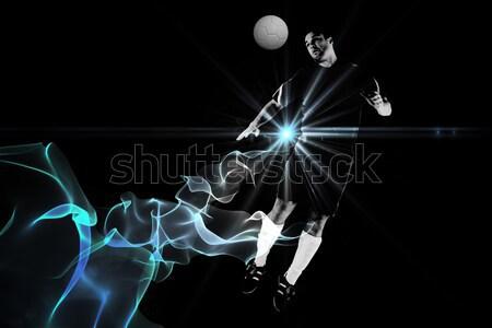 Composite image of goalkeeper in white jumping up Stock photo © wavebreak_media