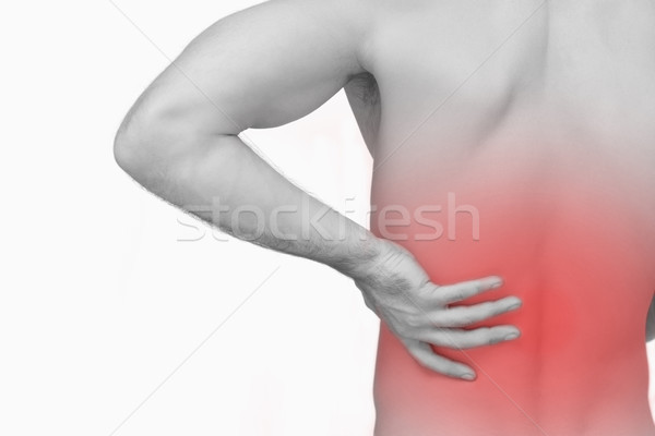 Rear view of shirtless man with hand on hip Stock photo © wavebreak_media