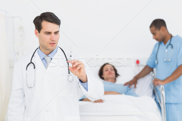 Médico jeringa paciente hospital grave Foto stock © wavebreak_media