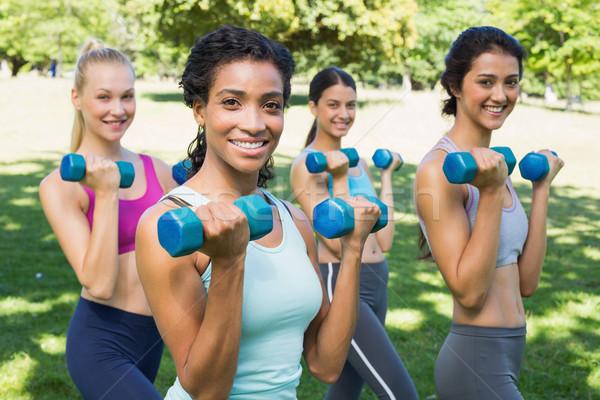 Confident sporty women lifting hands weights Stock photo © wavebreak_media