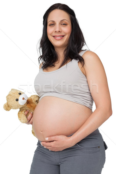 Femme enceinte Teddy souriant caméra blanche Photo stock © wavebreak_media