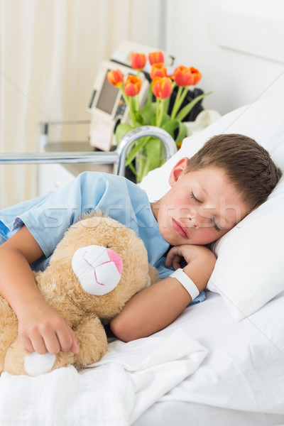 Boy with teddy bear sleeping in hospital Stock photo © wavebreak_media