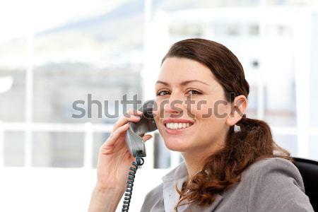 Cheerful girl sitting on sofa making a phone call Stock photo © wavebreak_media