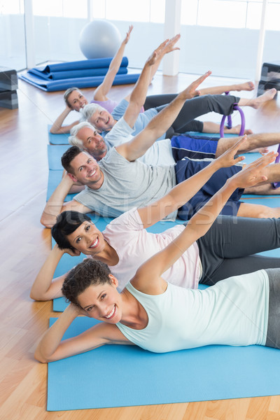 Fitness class stretching legs and hands in row Stock photo © wavebreak_media